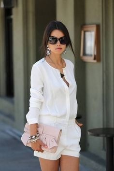 Classy white on white for summer - shorts, white blouse and blush clutch