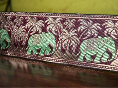 Green Maroon Gold, Brocade Silk Sari Border, Jacquard Weaving Border, Lace. Border has Elephant Parade through the tree all over and Trim is approx 2.5 inches wide. . This stunning lace can be used...