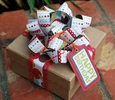 Scrapbook Paper Gift Bow.  Yes, my Christmas gifts will have these this year!