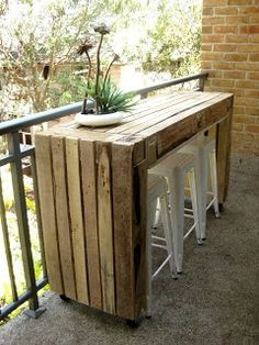 table like this might be nice for the long, narrow porch area.