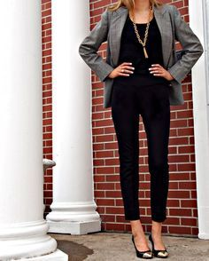 All black pants and top with a grey blazer coat and gold toed pointed pumps bold and business casual