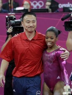 U.S. gymnast Gabrielle Douglas is hugged by coach Liang Chow after her performance on the floor during the artistic gymnastics women's individual all-around competition at the 2012 Summer Olympics, Thursday, Aug. 2, 2012, in London.