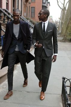 Look the best you possibly can in a black overcoat and black dress pants. Brown suede tassel loafers will contrast beautifully against the rest of the look.  Shop this look for $345:  http://lookastic.com/men/looks/tassel-loafers-dress-pants-watch-blazer-crew-neck-sweater-overcoat/6482  — Brown Suede Tassel Loafers  — Black Dress Pants  — Silver Watch  — Navy Blazer  — Grey Crew-neck Sweater  — Black Overcoat