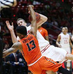 Utah Utes forward Jakob Poeltl (42) is fouled by Oregon State Beavers guard Langston Morris-Walker (13) during Pac-12 play in Salt Lake City Sunday, Jan. 17, 2016. Utah won 59-53.  (Jeffrey D. Allred, Deseret News)