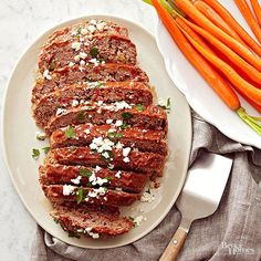 Tuck roasted sweet peppers, onion, and zucchini into a ground beef and lamb mixture to boost this slow cooker meat loaf's flavor and nutrients. Balsamic vinegar and crumbled feta cheese add Italian flavor to the simple supper.