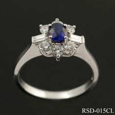 Cutting edge, stylish and chic; this contemporary sapphire and diamond cluster ring offers a new twist on a timesless design. The oval cut centre stone is claw set and surrounded by 6 x round cut diamonds with 2 x baguette cuts bringing a modern look to the ring. The elegant 18ct white gold mount compliments the over all design beautifully. £1400