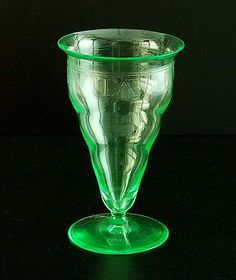 Liturgical green glass Misbeaker with engraved text Odor Vitae ad Vitam in rim design Dom Gregorius de Wit A.D.Copier 1928 executed by Glasfabriek Leerdam / the Netherlands