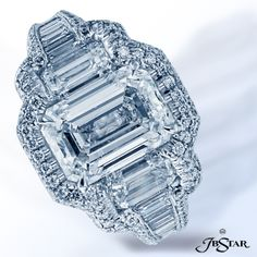 Style 7039  This exquisite platinum and diamond engagement ring features a beautiful 3.04ct emerald cut diamond with emerald cut and baguette diamond sides encircled with micro-pave diamonds.