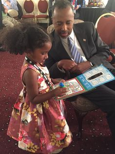 Dr. Ben Carson with his granddaughter right before the fourth GOP Presidential debate.