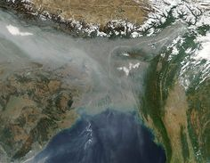 """A thick river of haze hovered over the Indo-Gangetic Plain in January 2013, casting a grey pall over northern India and Bangladesh...A study conducted by Tel Aviv University researchers and published in the American Journal of Climate Change found that levels of air pollution in large Indian cities increased at some of the fastest rates in the world between 2002 and 2010 – faster even than rapidly growing Chinese cities -Photograph: MODIS/Aqua/NASA"""