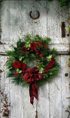 Distressed barn door with Christmas wreath