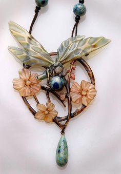 An Art Nouveau glass and carved/painted horn pendant necklace by Elizabeth Bonté circa 1900.