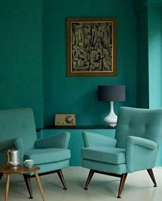 mid century modern, love the teal chairs- flanking the fireplace in main room? brings out the teal in the painting...