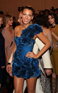 She is fashion perfection always. This dress is beautiful on her & the color is gorg!