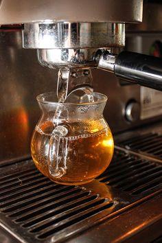 Pulling a pure tulsi shot at the Tea Bar