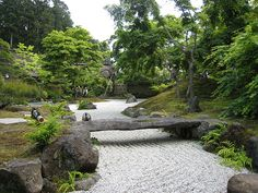 Japanese Rock Garden. This is so beautiful. Love the rock slab bridge and the river of sand