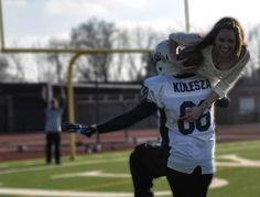 Cute engagement picture. My Fiance plays football and to me marriage=touchdown.