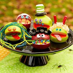 Apple Monsters Cut a wedge from apples to make a mouth, then decorate with candy.