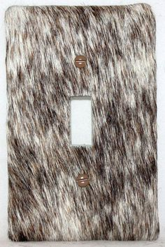 Cowhide switch plate