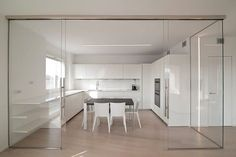Curves And Glass - An Interior With Varying Partitions Condo Interior, Interior Design Kitchen, Home Decor Kitchen, Kitchen Furniture, White Furniture, Sofa Set Designs, Modern House Plans, Sliding Glass Door, Wood Flooring