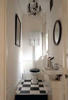 I love this bathroom. You have to step up to get into it. It is so cool and old timey.