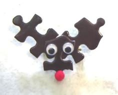 I made these for my oldest daughter's friends and teachers (almost 14 years ago) for Christmas....they are so easy to make and really cute!!  I added a pin to the back so they could wear these on a bow or on their tops (make sure the pin  has the loop and lack for safety).  puzzle piece reindeer