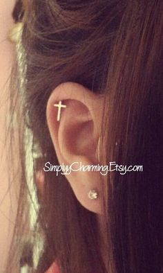 Tiny Cross Cartilage Earring In Silver by SimplyyCharming on Etsy https://www.etsy.com/listing/151857653/tiny-cross-cartilage-earring-in-silver