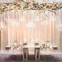 A collection of crystal chandeliers and a 24-ft high, #cherryblossom arrangement was suspended over this magnificent #cake and #dessert