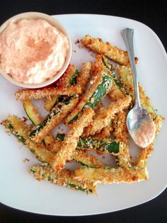 These are fabulous, low-calorie Baked Zucchini Fries with Creamy Parmesan Garlic Dip! It's the perfect side for the next burger night! sBaked Zucchini Fries | Epicurious Em