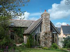 Traditionaly built stonework and Timber Frame cottage with glazing, sympathetic to the rest of the building.