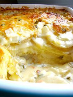Cheesy scalloped potatoes; 1/4 c. butter, 1 1/2 c. onion, 2 tbsp flour, 2 c. milk, 2 cloves garlic, 2 1/4 c. shredded cheese ( blend of cheddar, mozzarella, and monterey jack), divided, 1/3 c. chives, 4 large yukon gold potatoes