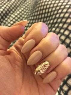 My nails  nude and gold glitter