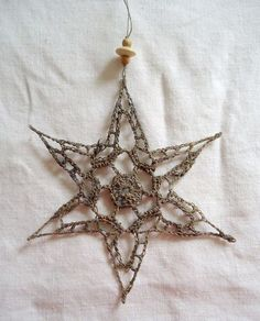 Gorgeous crochet star in silver thread ~