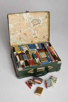 """Phase I"" Erin Ciulla, (Canada): Suitcase containing miniature books with mixed media, found materials, and handmade paper. Valise contenant des livres miniatures avec des médias mixtes, des matières trouvées et du papier fait-main (11.4 x 22.9 x 30.5 cm; 2005)"