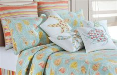Blue, yellow and coral coastal bedding. From Seaside Interiors. Love the pillows!