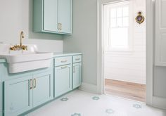 laundry room with aqua blue cupboards
