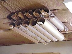Brilliant, out of the way storage for millwork and other long/thin and annoying objects.  Could be made stronger with PVC piping instead of the cardboard tubes.  Photo instructions.