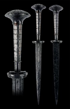"""Landsknecht Dagger, South German or Swiss, first half of the 16th century All-steel hilt with six-sided conical grip and mushroom-shaped pommel. Ring guard on one side. Blade has multiple fullers on the front and is flat on the back. Overall length: 27.5 cm (10.8""""); Blade length: 16.7 cm (6.6"""") Located at Reichsstadtmuseum Rothenburg, Germany"""