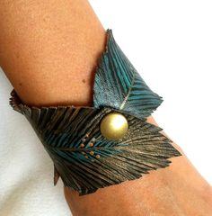 Just bought this...Feather Cut Cuff, Gold Turquoise Feather Bracelet Faux Leather Hand Painted