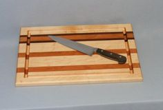 Large Maple Cherry Walnut Cutting Board with Juice Groove by Pauls. $49.00. Handmade in the USA. Gift Wraped. Large 12x18x3/4 inches. Juice Groove. Solid Wood. This cutting board is made of Appalachian maple, cherry and walnut hardwoods. It is 12X18X3/4 inches giving you a generous size working surface for food preparation and chopping. This board features a groove on one side and is flat on the other.  This size is my best seller. It is perfect for everyday use full...