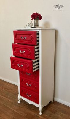 Lingerie Chest. Red drawer fronts with black and white striped insides. Would love to repurpose an old dresser like this!