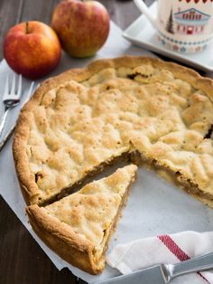 Covered German Apple Cake is one of the best apple cakes! Filled with cinnamon-seasoned apple chunks and topped with a vanilla shortbread crust.
