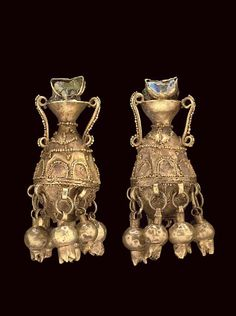 Gold and glass amphora-shaped Parthian earrings with pomegranate details, c. 1st-2nd centuries CE. From Christie's Auctions.