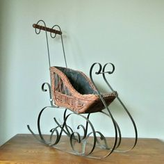 Antique wicker and iron sleigh