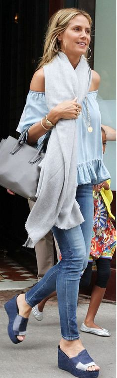 Who made Heidi Klum's denim off the shoulder top and gray handbag?