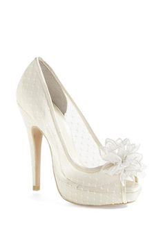 Free shipping and returns on Menbur 'Adelia' Sandal at Nordstrom.com. Say 'I do' to a gorgeous bridal peep-toe pump crafted in pristine mesh and capped with a fluttery blossom.