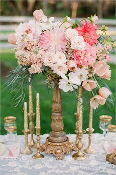 See more pink and gold floral centerpieces here http://www.weddingchicks.com/2013/06/27/pink-and-gold-wedding/