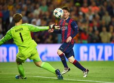 Lionel Messi of Barcelona chips the ball over goalkeeper Manuel Neuer of Bayern München to score his team's second goal during the UEFA Champions League Semi Final, first leg match between FC Barcelona and FC Bayern München at Camp Nou on May 6, 2015 in Barcelona, Catalonia.