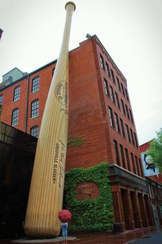 The Louisville Slugger Museum is the home of the largest baseball bat in the world, and also the factory where all Louisville Slugger bats are made! It's one of the coolest places to visit in Louisville. Louisville Slugger, Louisville Kentucky, Louisville Baseball, Unusual Buildings, My Old Kentucky Home, Roadside Attractions, Water Tower, World's Biggest, Sculpture