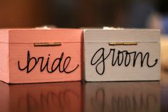 Ring Boxes instead of a pillow! decorated; girlie for me, manly design for the groom